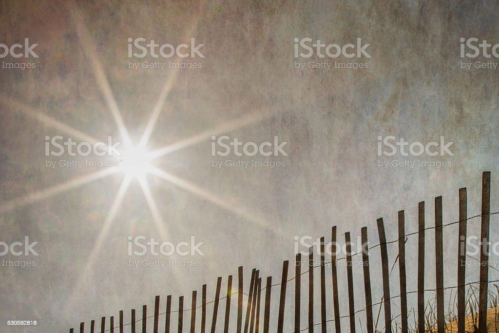Sun Over Sand Fence stock photo