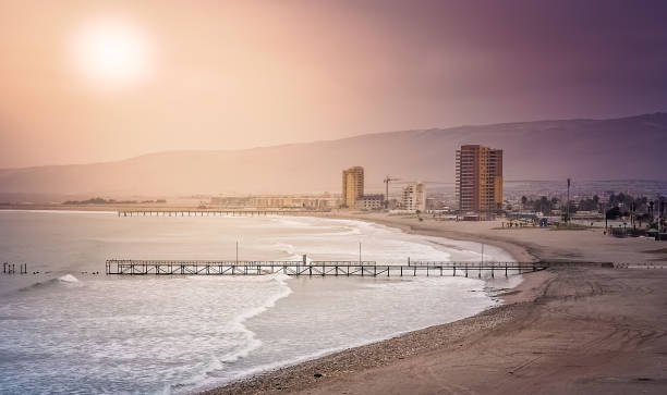 Sun over the beach in Arica stock photo