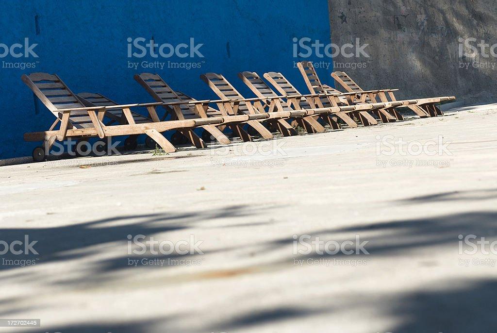 Sun Patio and Teakwood Deck Chairs stock photo