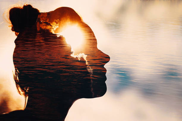 Sun peeks out from behind the clouds in woman's head Sun peeks out from behind the clouds in woman's head. sensory perception stock pictures, royalty-free photos & images