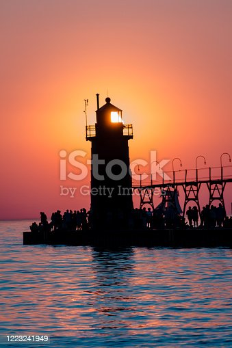 177362898 istock photo Sun perfectly framed in South Havens lighthouse at sunset 1223241949