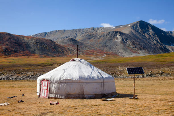 Sun powered traditional Mongolian ger in Altai Mountains Mongolia Traditional Mongolian portable round tent ger covered with white outer cover powered by solar panel in Altai Mountains of Western Mongolia mongolian culture stock pictures, royalty-free photos & images
