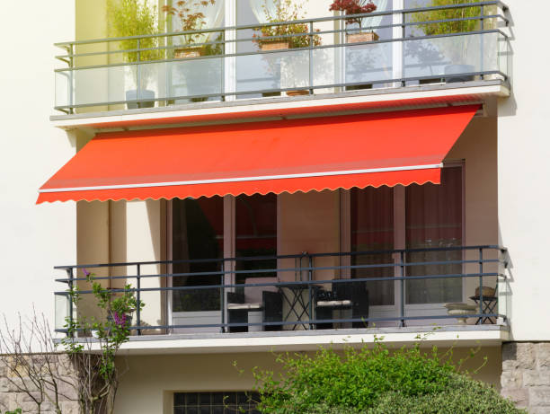 Sun protection awning at French balcony stock photo