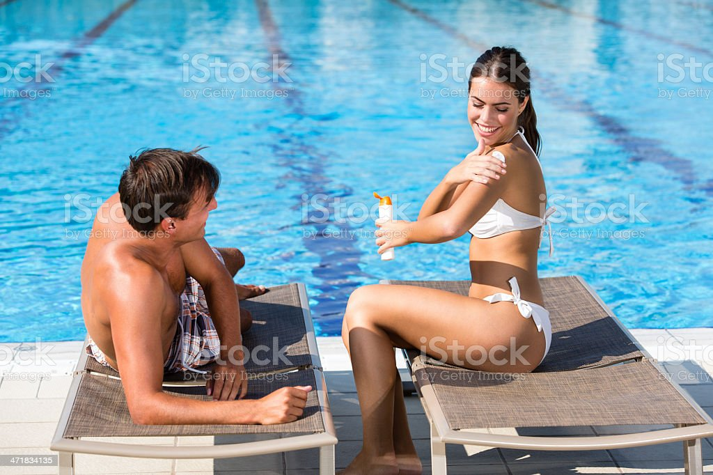 Sun protection by the swimming pool royalty-free stock photo