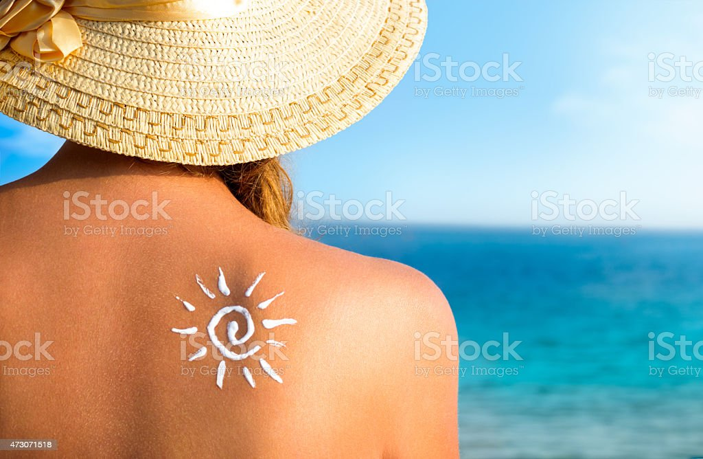 Sun protection, girl using sunscreen to safe her skin healthy stock photo
