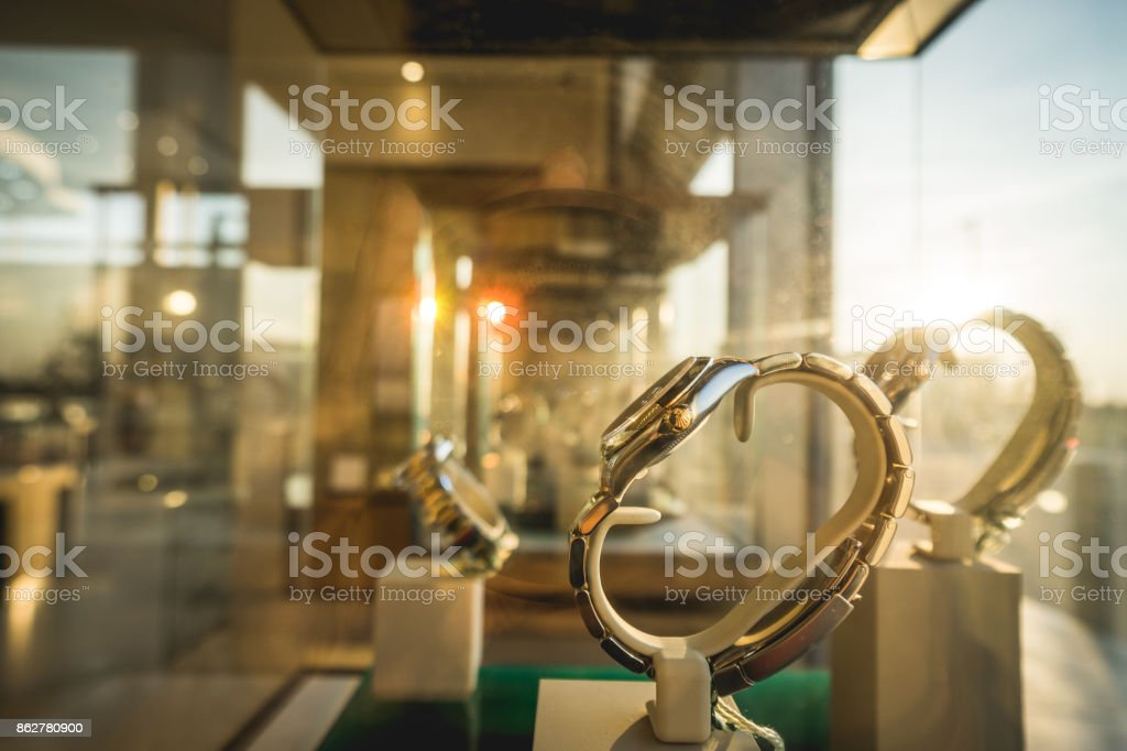 Sun ray on luxury watches displayed in shopwindow stock photo
