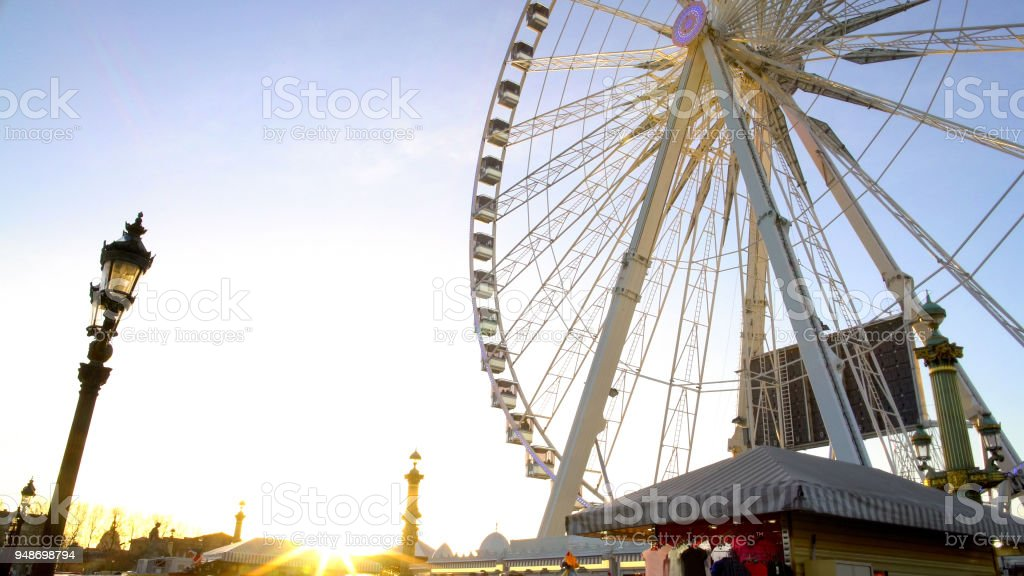 Sun ray penetrating giant construction of observation wheel, theme park, Paris stock photo