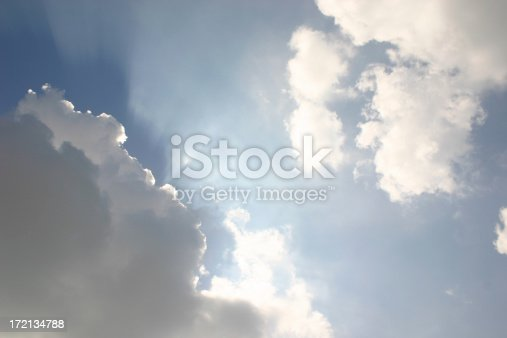 Clouds with sun rays peaking from behind