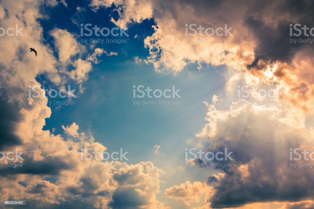 Sun rays and blue sky with dramatic clouds - Royalty-free Abstract Stock Photo