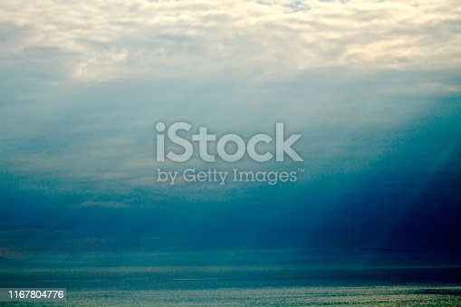Sun rays beaming from clouds, nature, backgrounds