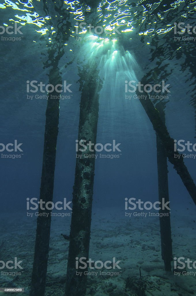 Sun rays below the water surface stock photo