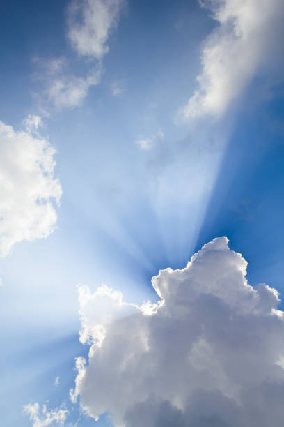 Sun rays breaking through the cloud stock photo