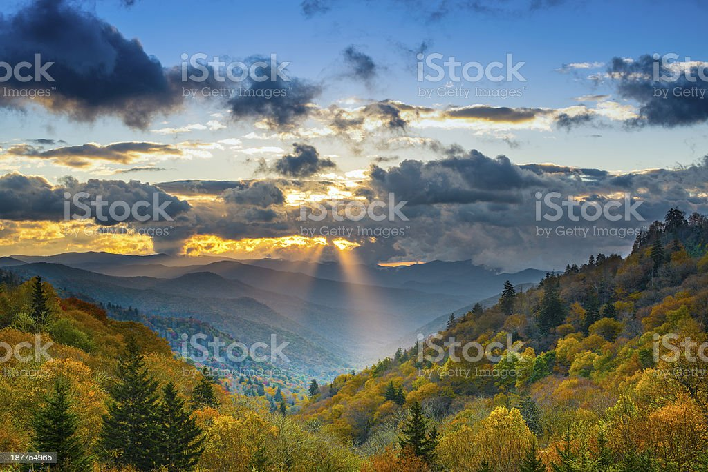 Sun rays coming through clouds in beautiful Smoky Mountains stock photo