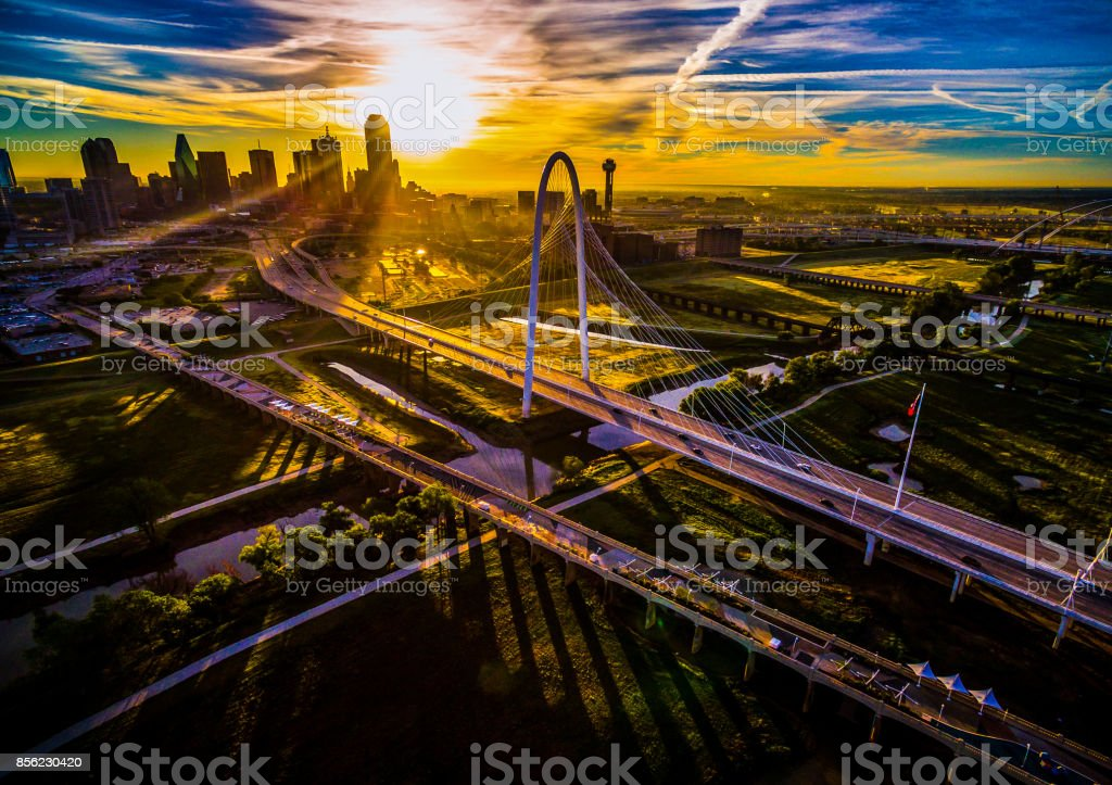 Sun rays glow across Dallas , Texas , USA Aerial Drone View high above North Texas Cityscape at sunrise stock photo