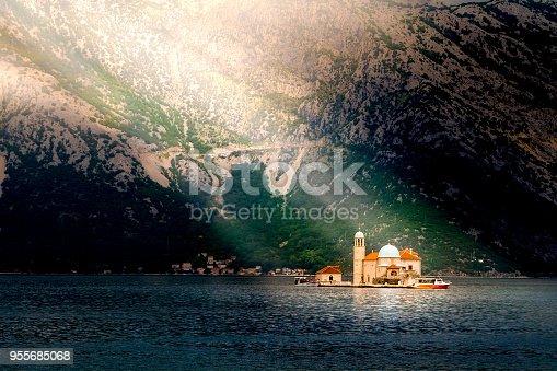 istock Sun rays illuminate the island at Boka Kotor bay (Boka Kotorska), Montenegro 955685068
