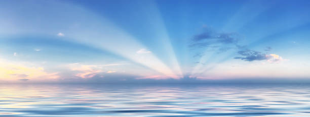 sun rays in blue sky over sea - atlantic ocean stock pictures, royalty-free photos & images