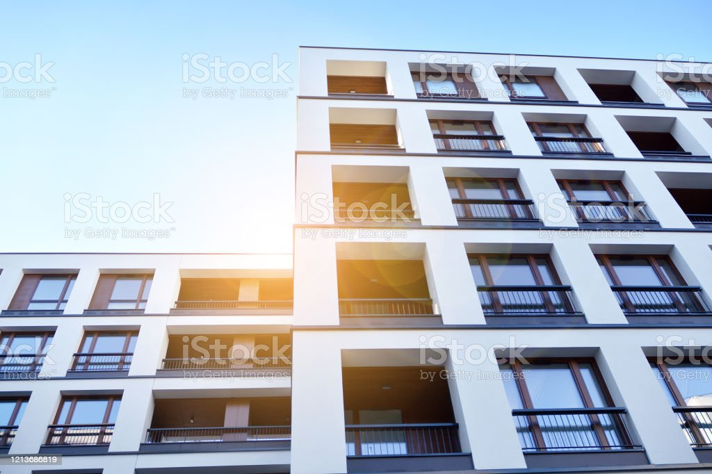 Sun Rays Light Effects On Urban Buildings Fragment Of Modern Residential Apartment With Flat Buildings Exterior Stock Photo Download Image Now Istock