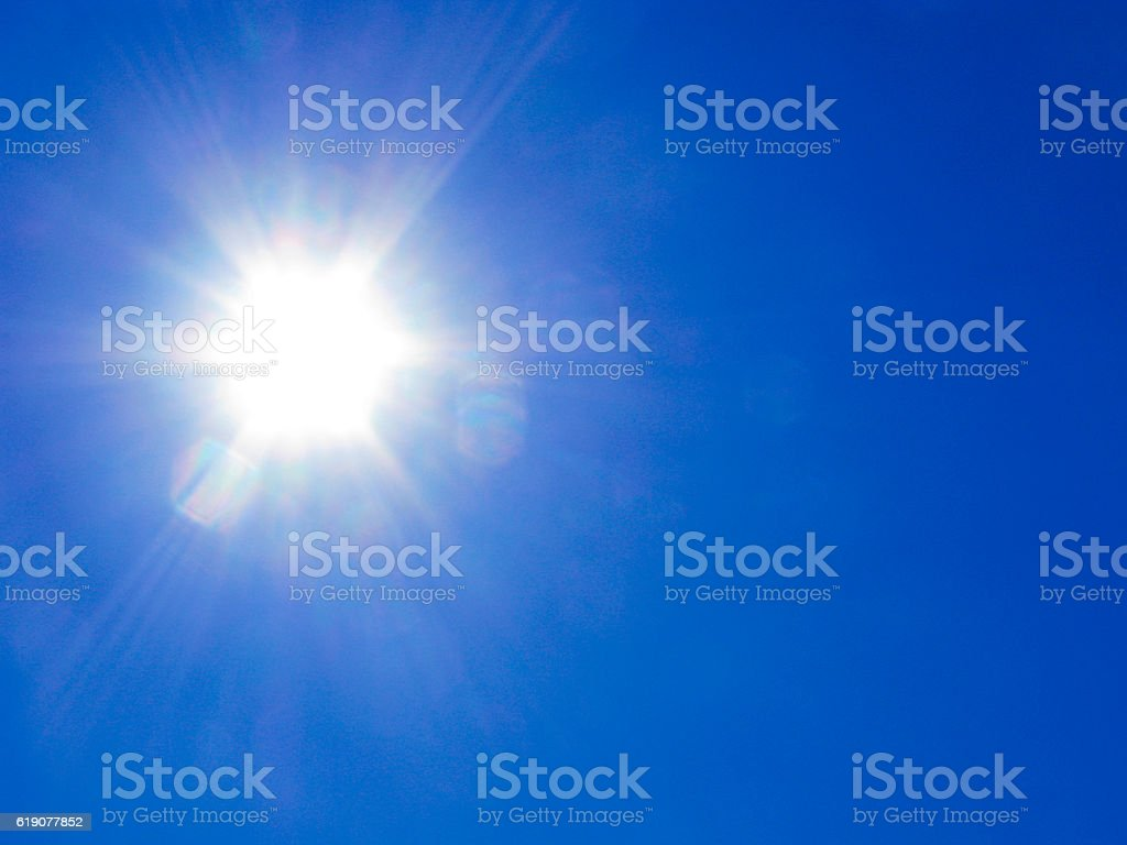 Sun rays on blue sky stock photo