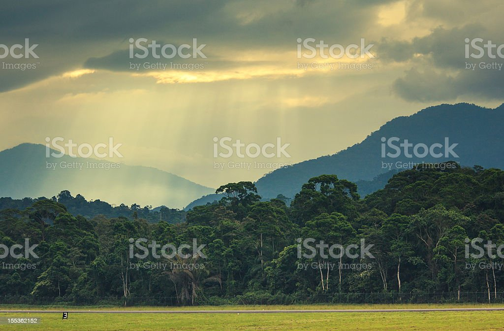 sun rays over the mountains in honduras stock photo
