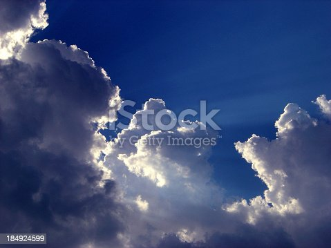 A ray of sun shining through the clouds on a deep blue sky kind of day. To see full my collection of cloudscapes click on the photos below: