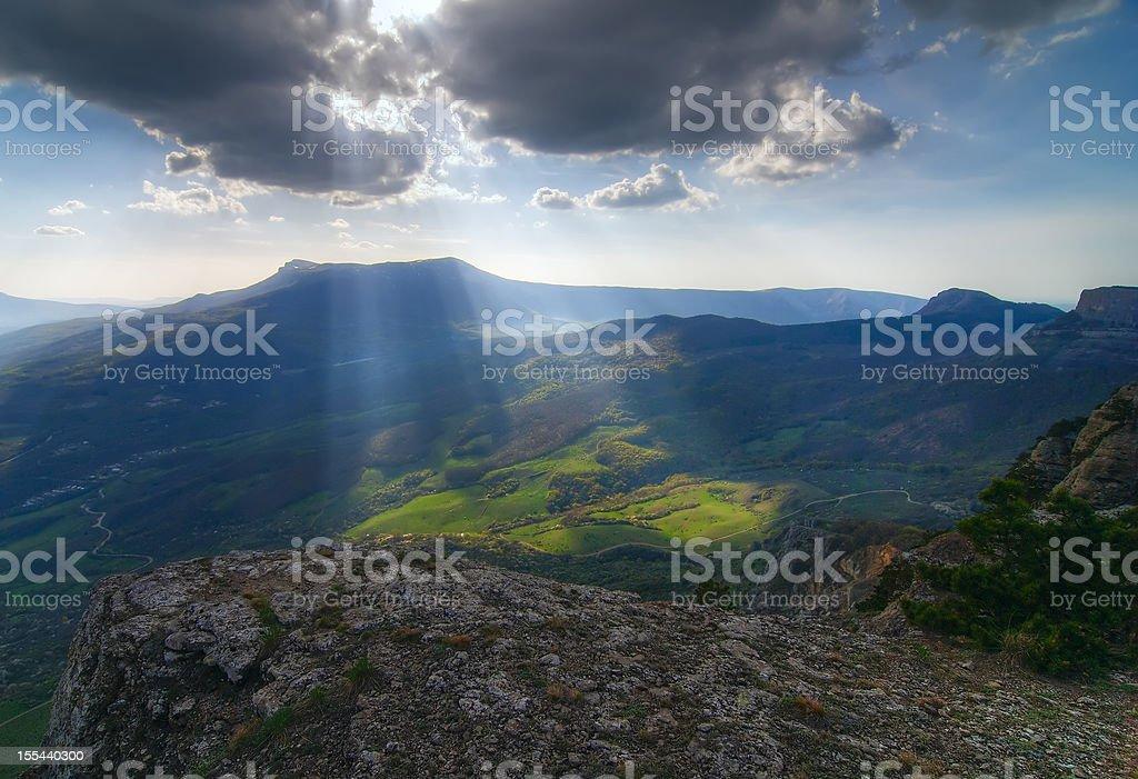 Sun rays struggle through the clouds stock photo
