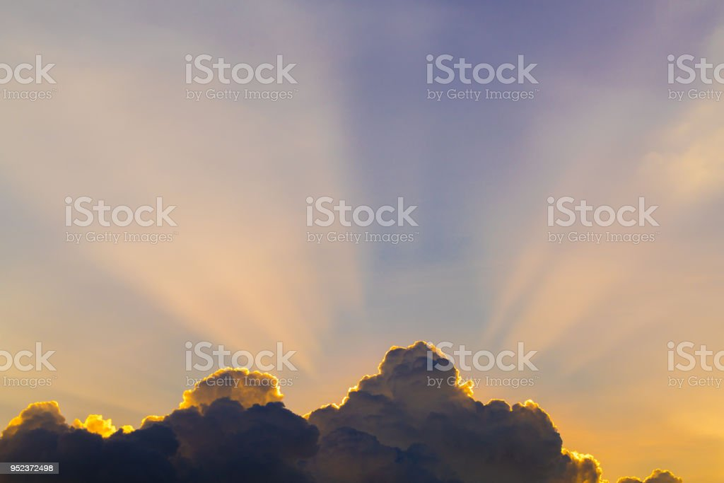 Sun rays through clouds like an dramatic explosion , power nature...