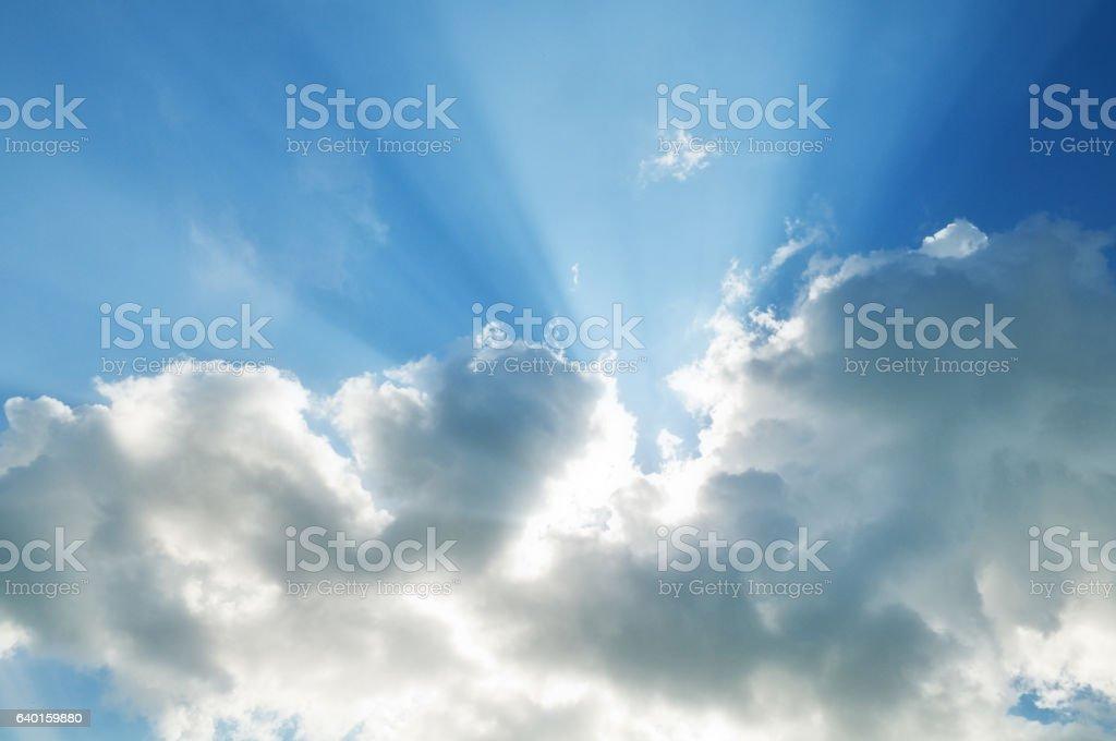 Sun rays through clouds. stock photo
