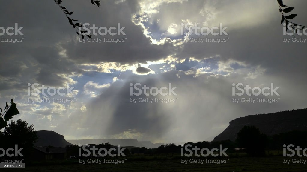 Sun rays through monsoon clouds and sun flare over the Virgin River...