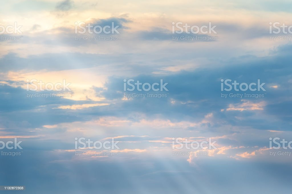 Sun streams coming through pastel cloudscape