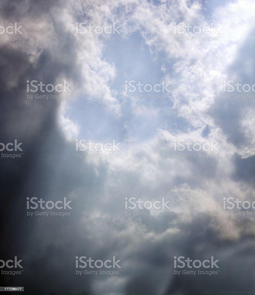 Sun Rays Through Stormy Heart Shaped Cloud stock photo