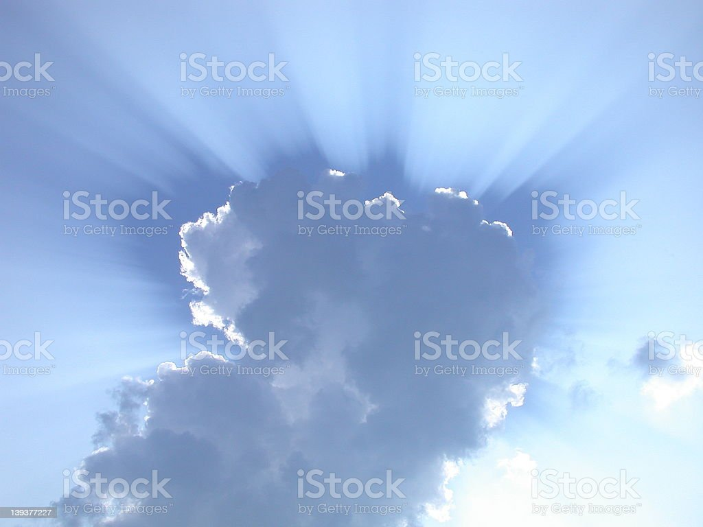 Sun Rays through the clouds stock photo