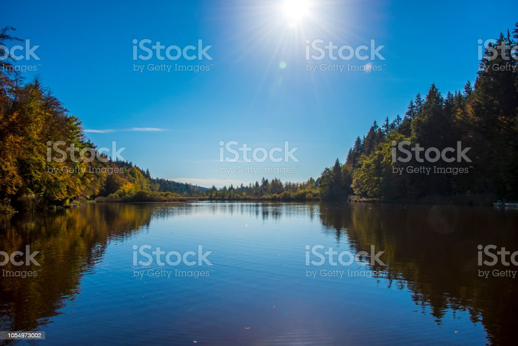 Sun reflected in the lake. stock photo