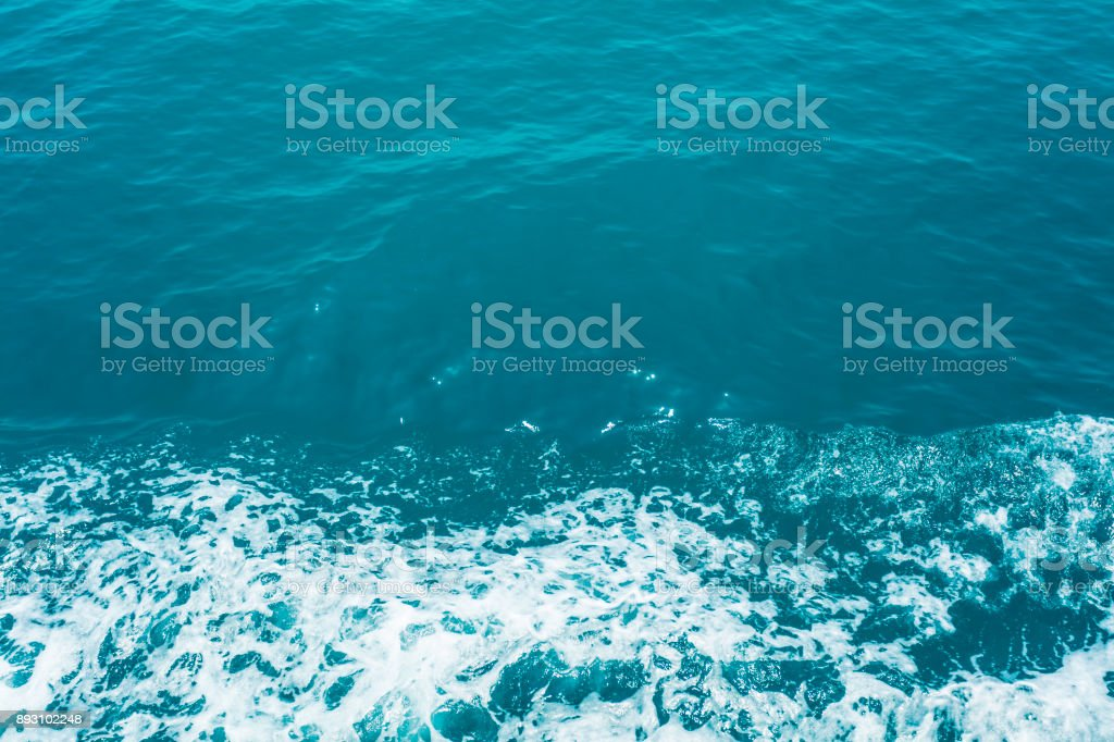 Sun reflections in sea water from above stock photo