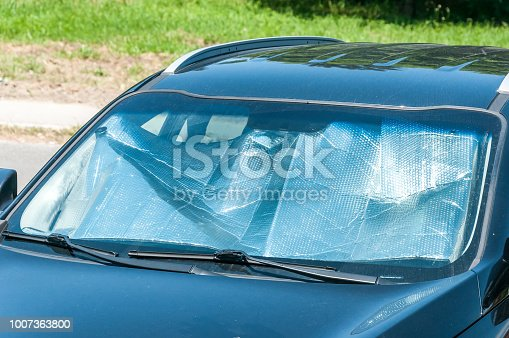 istock Sun reflector on the windscreen or windshield as protection of the car plastic indoor panel from direct sunlight and heat 1007363800