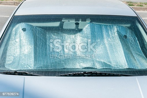 istock Sun reflector on the windscreen or windshield as protection of the car plastic indoor panel from direct sunlight and heat 977526274