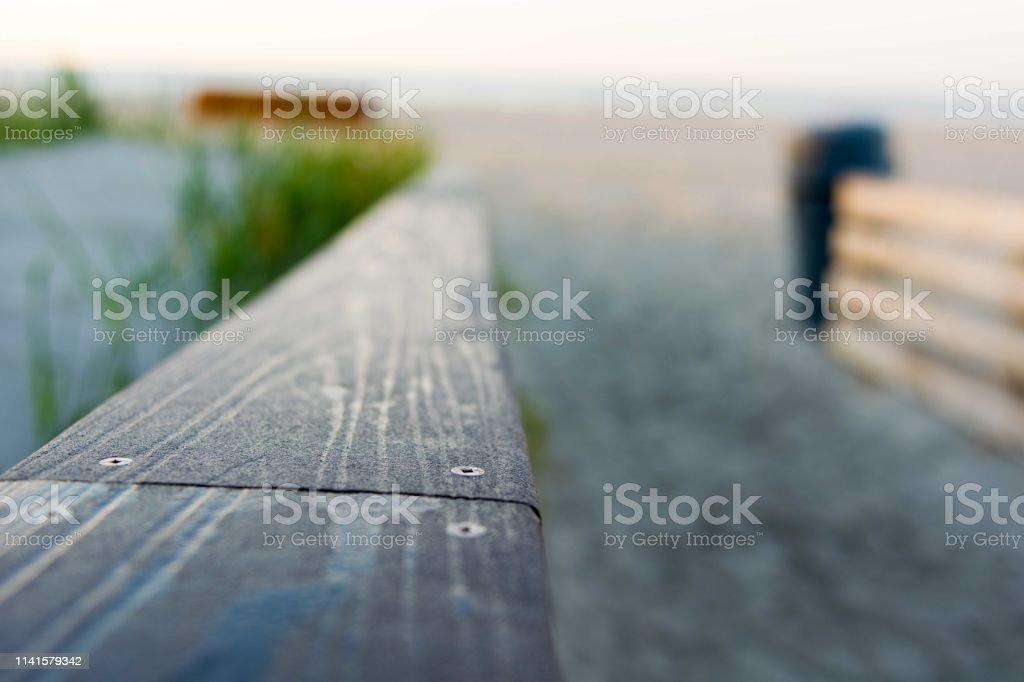 Sun reflects off a wood railing stock photo