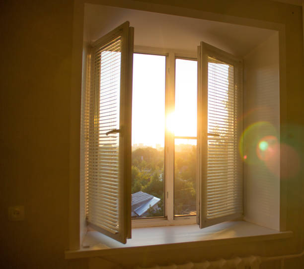 sun rise behind the window blinds and curtains shades