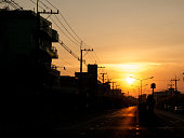 The Sun Rises behind The City Streets in The Morning