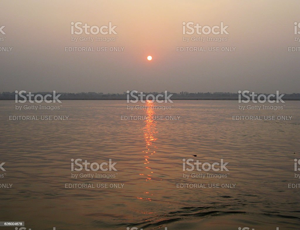 Sun rises over Ganges river in Varanasi stock photo