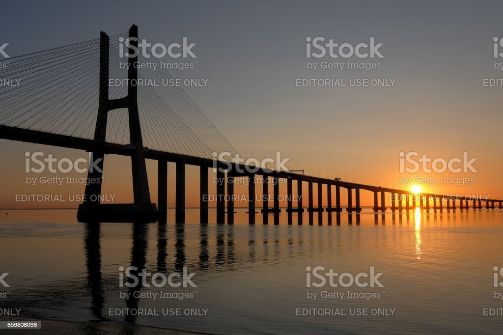 Sun Rising at the Vasco da Gama Bridge stock photo
