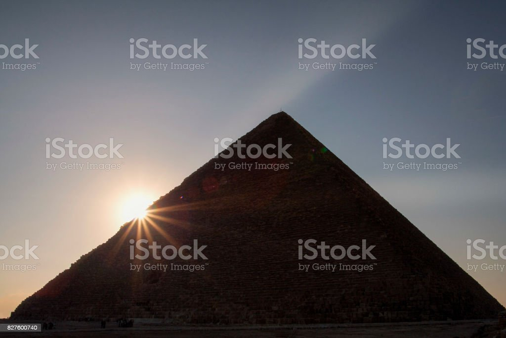 Sun rising behind the Great Pyramid  of Giza. stock photo