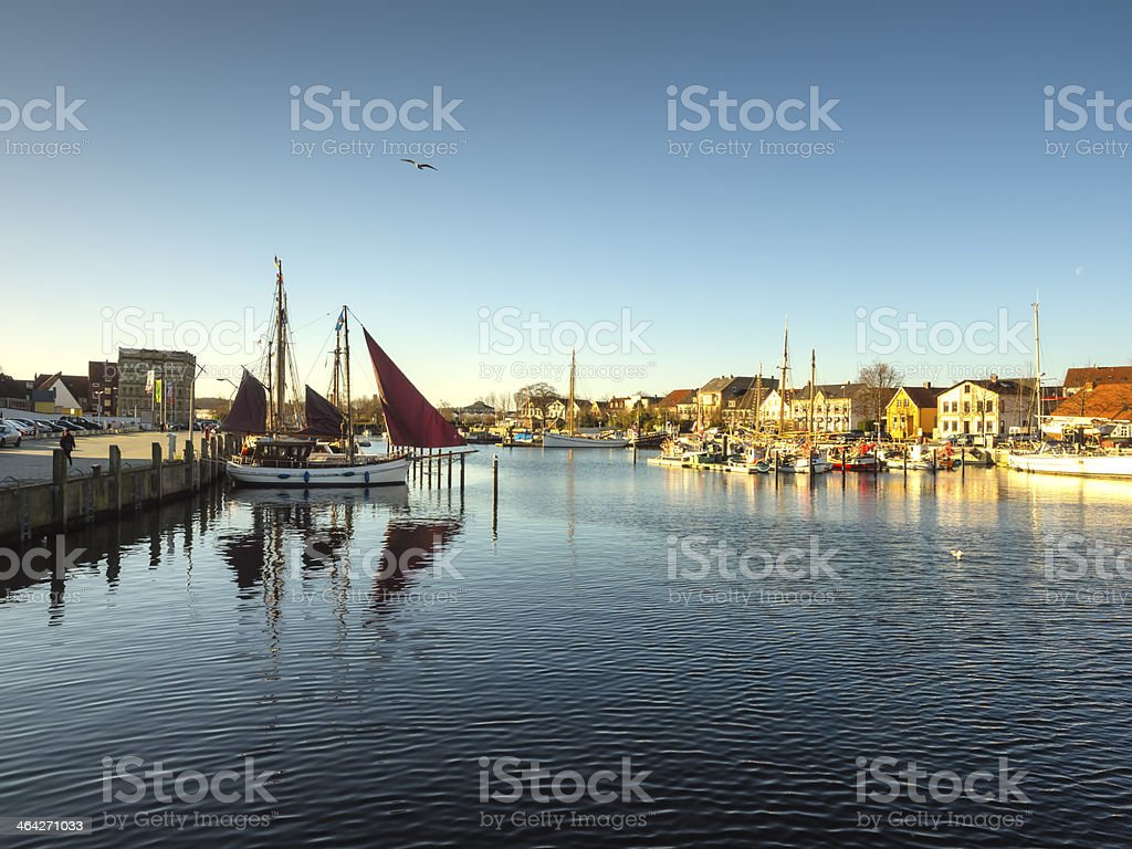 Sun rising in Eckernfoerde, Germany over an old harbor stock photo