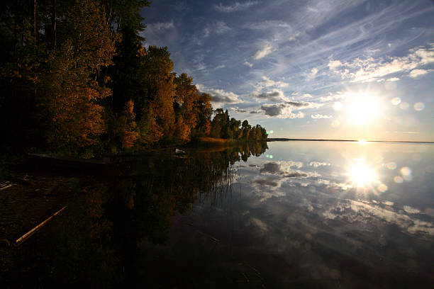 Sun rising over a Saskatchewan lake stock photo