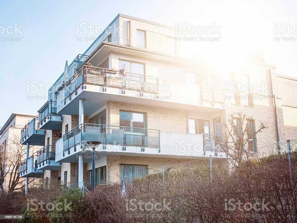 Sun rising over modern apartment building stock photo