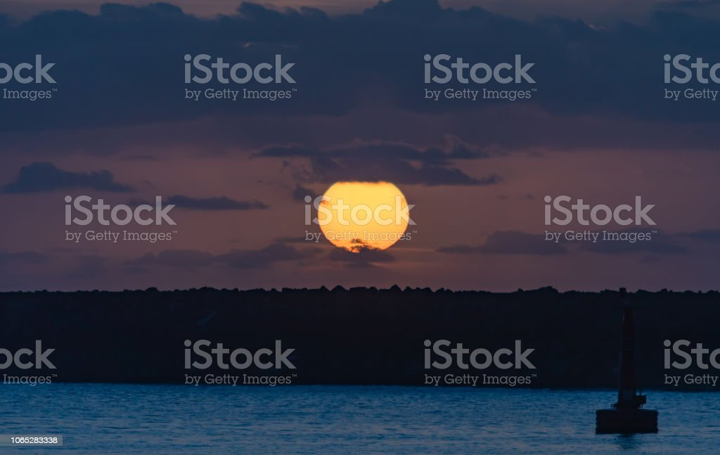 Sun Rising over the Breakwall Seascape stock photo