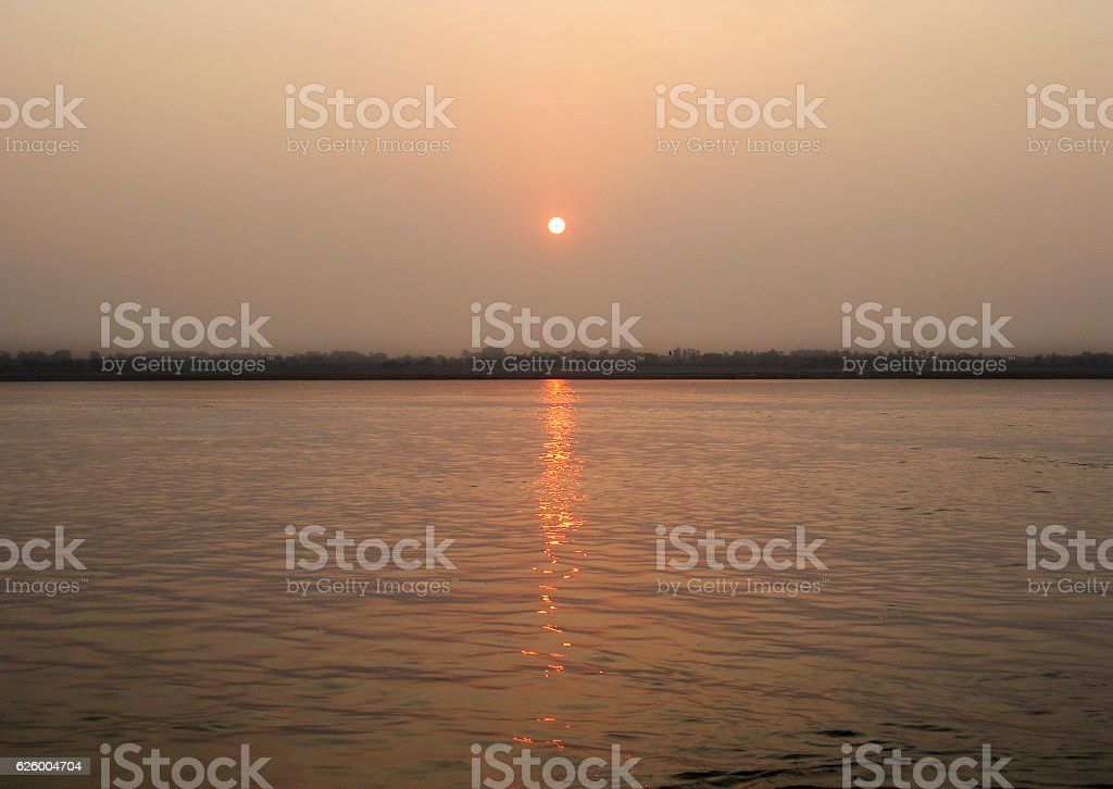 Sun rising over the Ganges river in Varanasi stock photo