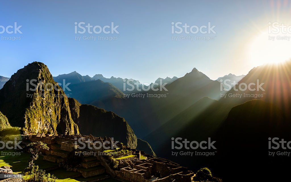 Sun rising over the mountains at Machu Picchu, Peru stock photo
