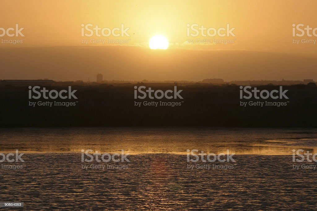 sun rising over the saltern royalty-free stock photo