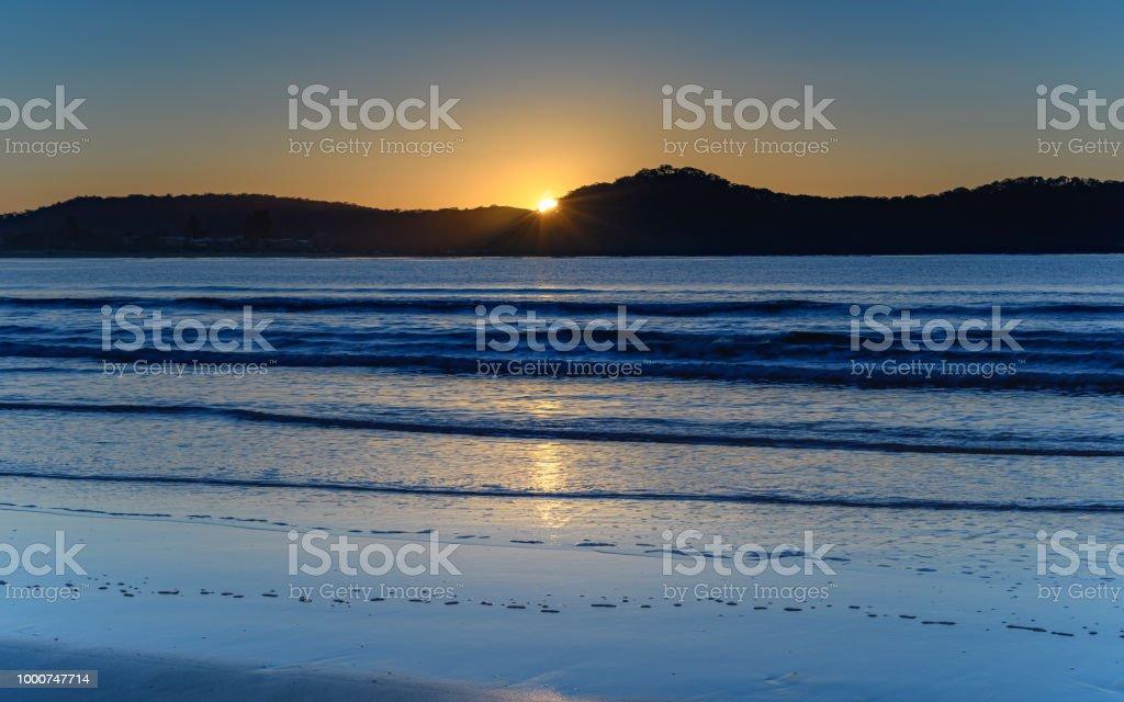 Sun Rising Seascape stock photo