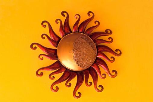 Decorative art still life of sun shaped metalwork